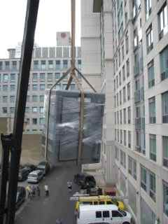 Craning sofa off a building.