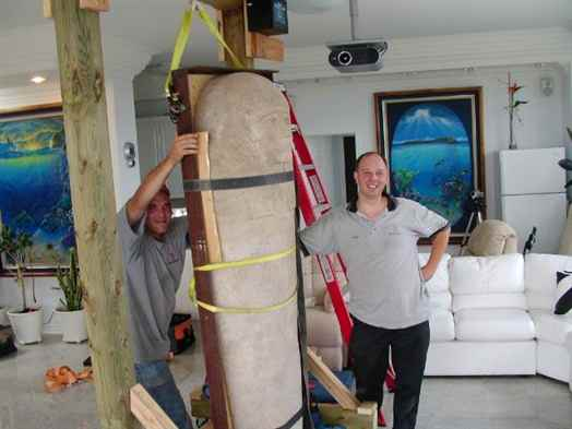 Moving a priceless Egyptian Sarcophagus lid into a condo.