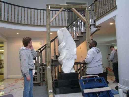 Moving a sculpture.