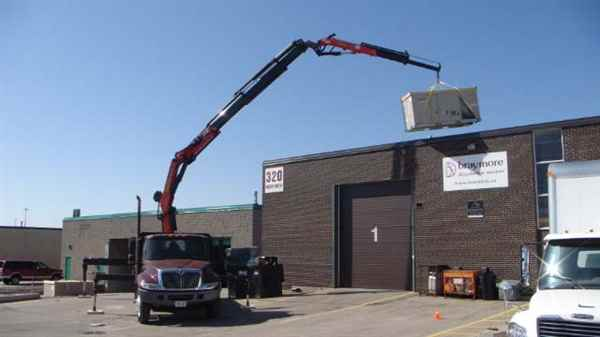 Crane HVAC onto roof