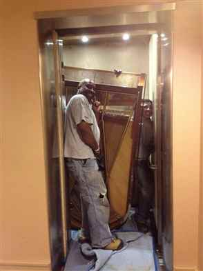Squeezing a grand piano into a small elevator