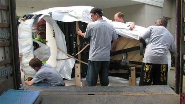 Dont you love those power tailgates that safely lift the piano down onto the ground.