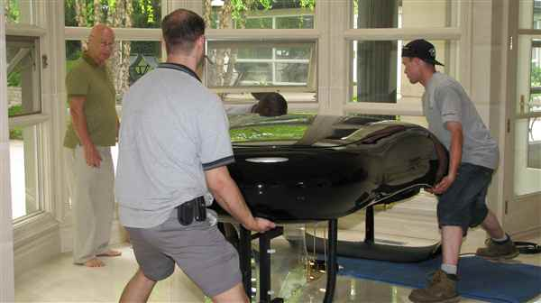 Rotating the grand piano into final position.