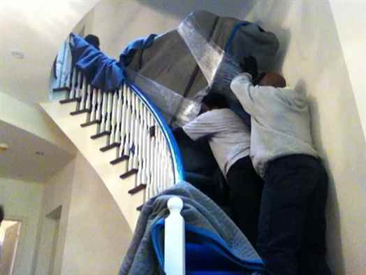 Moving a grand piano up a spiral staircase.