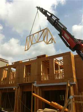 Crane roofing trusses in Toronto