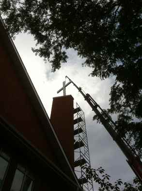 Crane cross onto church