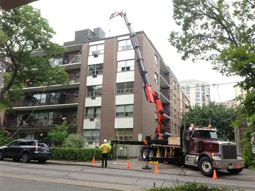 Craning Building Materials onto roof of building in Toronto