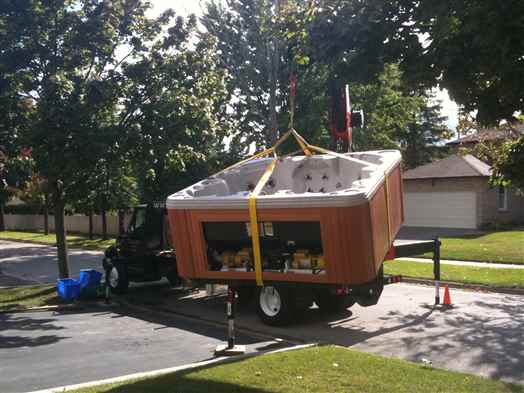 Craning a hot tub off our truck.