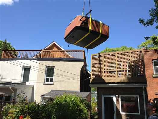 Lifting hot tub from balcony.