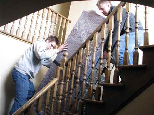 Taking a wine cooler down a flight of stairs with a very tight turn.