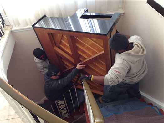 Taking an upright piano down a flight of stairs with a really tight turn.