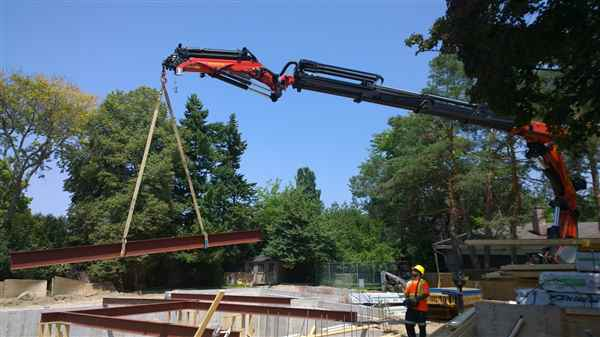 Crane steel beam into place.
